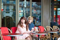 Dating couple drinking coffee in a Parisian cafe Stock Photo