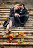 Dating couple at fall. Sitting on a stairway stock photos