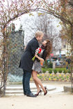 Dating couple hugging under an arch. Dating couple hugging under beautiful arch Royalty Free Stock Photos