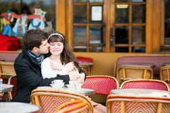 Dating couple kissing in a cafe Stock Image