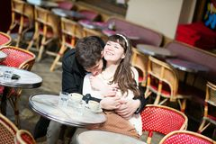 Dating couple kissing in a cafe Stock Photography