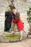 Dating couple kissing in a garden Royalty Free Stock Photography