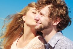 Dating. Couple in love kissing. Happiness dating concept. Couple in love blonde women handsome bearded men enjoy romantic date kissing, outdoor wide angle view Royalty Free Stock Images