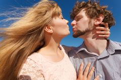 Dating. Couple in love kissing. Happiness dating concept. Couple in love blonde women handsome bearded men enjoy romantic date kissing, outdoor wide angle view royalty free stock photos