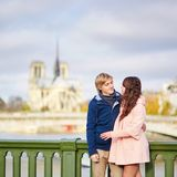 Dating couple near Notre-Dame de Paris Royalty Free Stock Photography