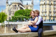 Dating couple near Notre-Dame in Paris Stock Photography