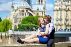 Dating couple near Notre-Dame in Paris Stock Photo