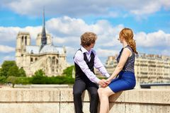 Dating couple near Notre-Dame in Paris Stock Photos