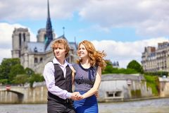 Dating couple near Notre-Dame in Paris Royalty Free Stock Photography