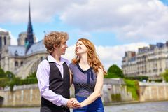 Dating couple near Notre-Dame in Paris Royalty Free Stock Images