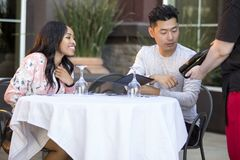 Dating Couple Ordering at an Outdoor Restaurant stock images