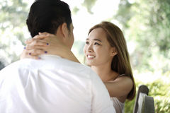 Dating couple outdoors in a happy relationship Stock Photos
