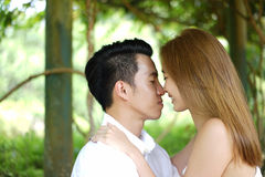 Dating couple outdoors in a happy relationship Royalty Free Stock Photo