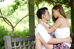 Dating couple outdoors in a happy relationship Royalty Free Stock Images