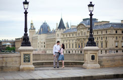 Dating couple in Paris. On a bridge stock photography