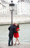 Dating couple in Paris. Kissing at the embankment stock photo
