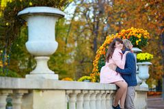 Dating couple in Paris on a fall day. Young dating couple in the Luxembourg garden of Paris on a bright fall day stock images