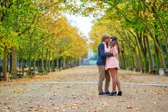 Dating couple in Paris on a fall day. Young dating couple in the Luxembourg garden of Paris on a bright fall day royalty free stock image