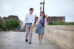 Dating couple in Paris walking hand in hand stock photo