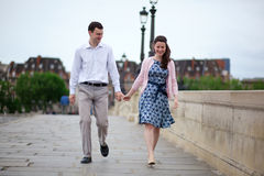 Dating couple in Paris walking hand in hand Royalty Free Stock Image