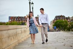 Dating couple in Paris walking hand in hand. Positive dating couple in Paris walking hand in hand royalty free stock photos