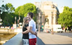 Dating couple on a Parisian street stock photography