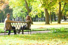 Dating couple in park Stock Photos