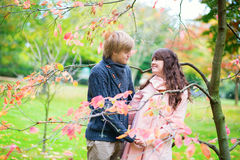 Dating couple in park on a fall day Royalty Free Stock Photos