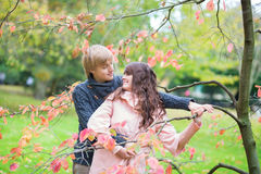 Dating couple in park on a fall day Royalty Free Stock Images