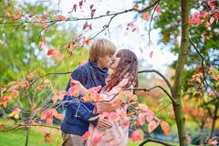 Dating couple in park on a fall day Stock Photography