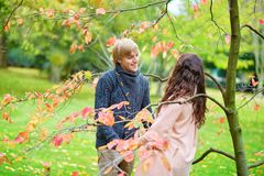 Dating couple in park on a spring or fall day Royalty Free Stock Photography