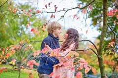 Dating couple in park on a spring or fall day Stock Photos