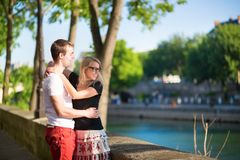 Dating couple on the Seine embankment Stock Photos