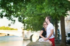 Dating couple on the Seine embankment Royalty Free Stock Image