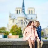 Dating couple on the Seine embankment in Paris Stock Photo