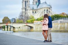 Dating couple on the Seine embankment in Paris Royalty Free Stock Images