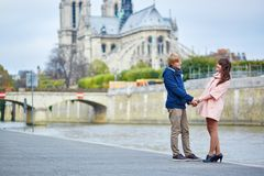 Dating couple on the Seine embankment in Paris Royalty Free Stock Photography