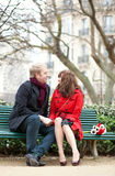Dating couple sitting on a bench Royalty Free Stock Images