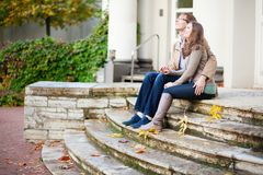 Dating couple sitting on the stairs Stock Photo