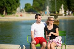 Dating couple in the Tuileries garden of Paris Royalty Free Stock Photography