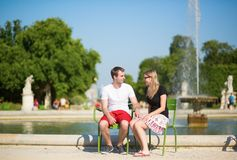 Dating couple in the Tuileries garden of Paris Royalty Free Stock Image