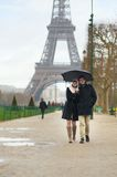 Dating couple under the rain Royalty Free Stock Images