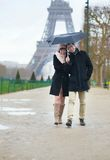 Dating couple under the rain in Paris Stock Photo
