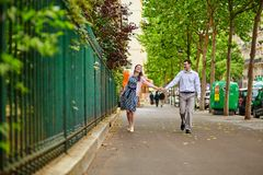 Dating couple is walking in Paris Stock Images