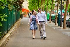 Dating couple is walking in Paris Stock Photos