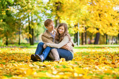 Dating couple in yellow leaves on a fall day Stock Image