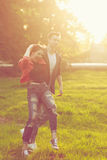 Dating couples in park at sunset Stock Photo