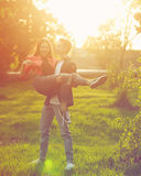Dating couples in park at sunset Stock Photography