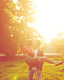 Dating couples in park at sunset Stock Image