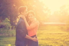 Dating couples in park at sunset Royalty Free Stock Photography